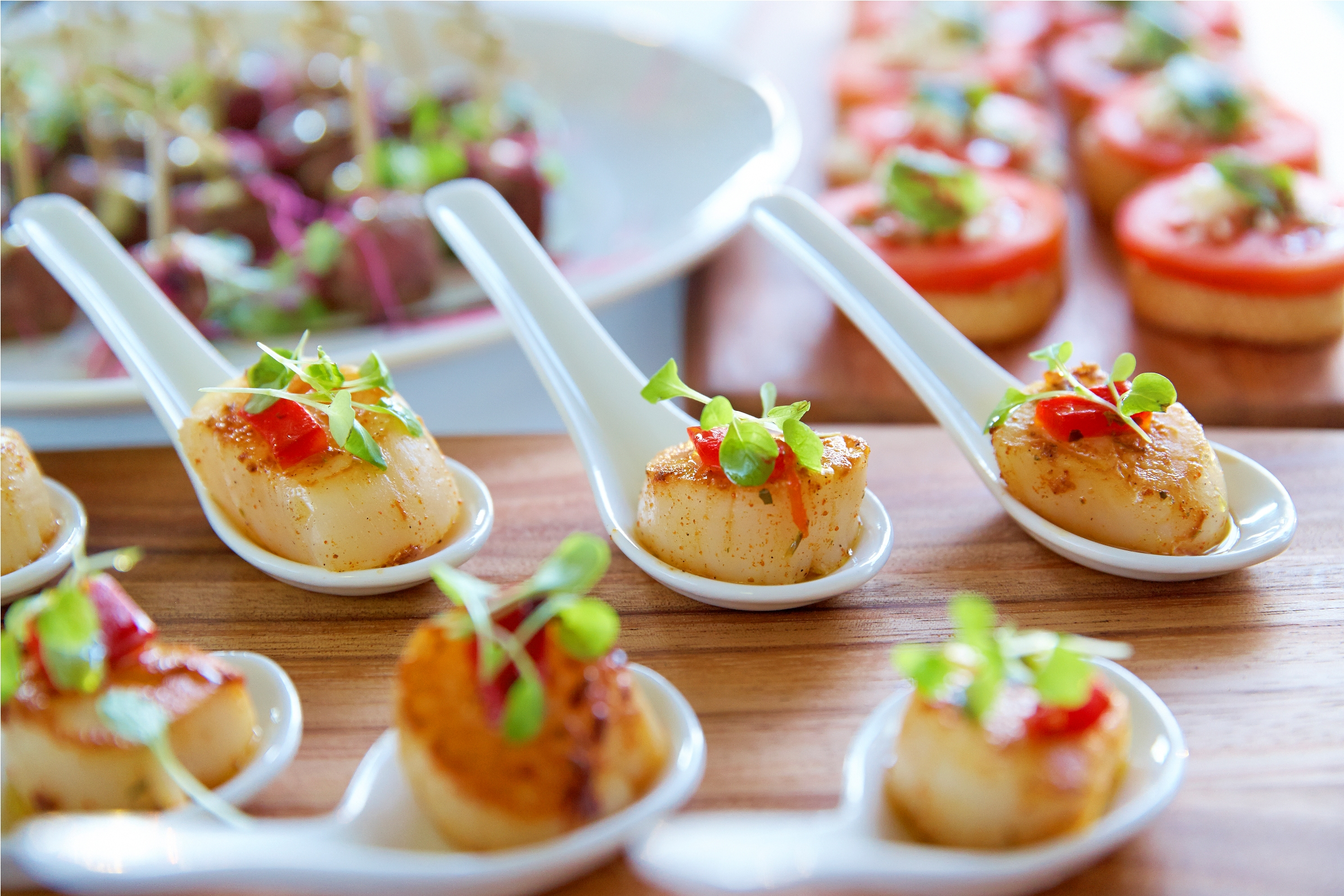 Cajun scallops from the deluxe canape event catering menu at Holiday Inn Potts Point.