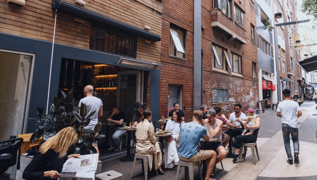 Patrons enjoying breakfast at laneway cafe Room 10 in Potts Point.
