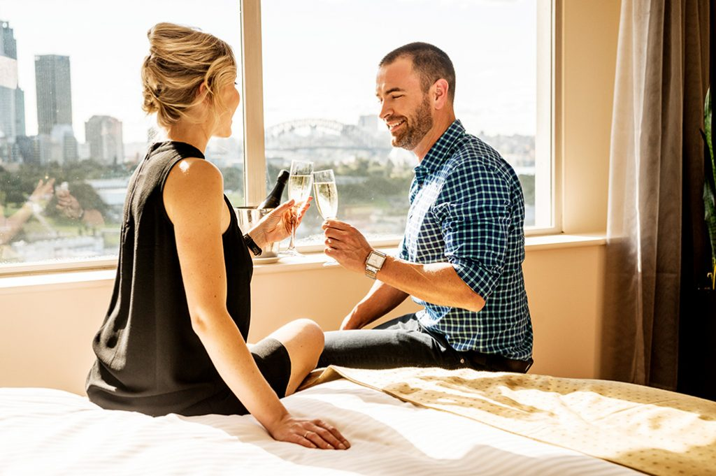 Couple in Harbour View Room, Holiday Inn Potts Point