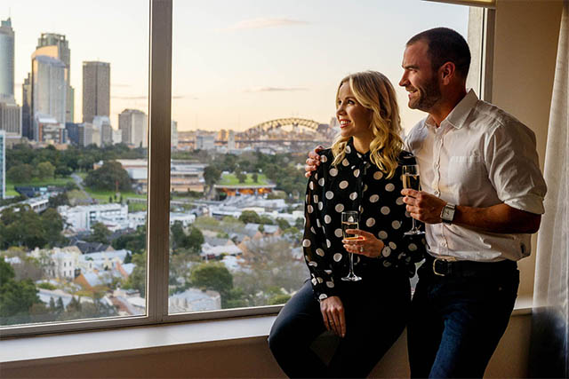 Couple in Harbour View Room at Holiday Inn Potts Point